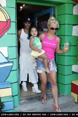 Kevin, Britney, and a midget walking out of a giant lego house